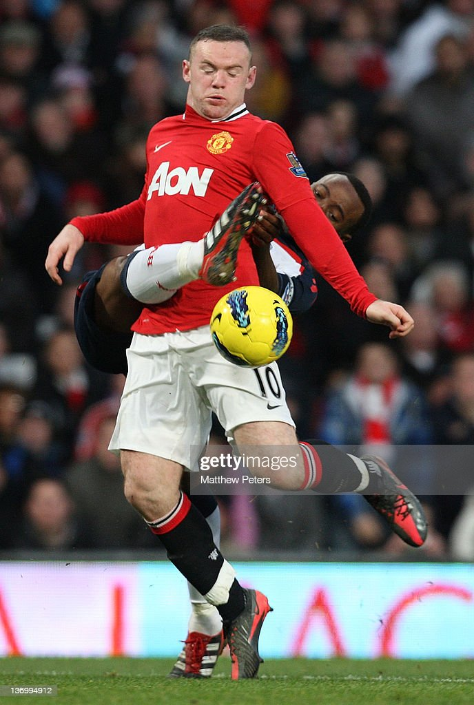 <a gi-track='captionPersonalityLinkClicked' href=/galleries/search?phrase=Wayne+Rooney&family=editorial&specificpeople=157598 ng-click='$event.stopPropagation()'>Wayne Rooney</a> of Manchester United clashes with <a gi-track='captionPersonalityLinkClicked' href=/galleries/search?phrase=Nigel+Reo-Coker&family=editorial&specificpeople=214185 ng-click='$event.stopPropagation()'>Nigel Reo-Coker</a> of Bolton Wanderers during the Barclays Premier League match between Manchester United and Bolton Wanderers at Old Trafford on January 14, 2012 in Manchester, England.