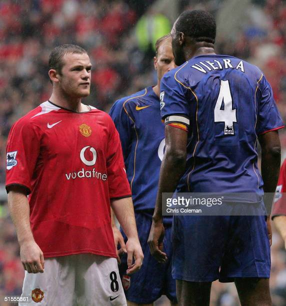 Wayne Rooney of Manchester United clashes with Patrick Vieira of Arsenal during the Barclays Premiership match between Manchester United and Arsenal...