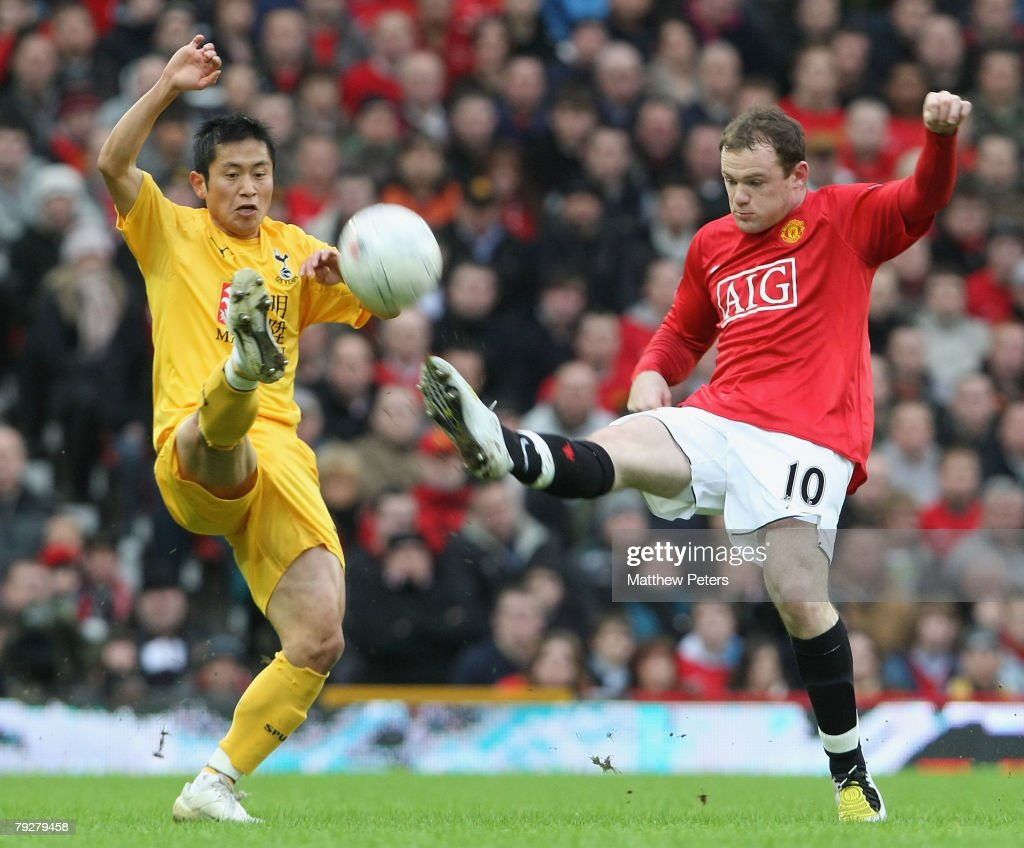 Wayne Rooney of Manchester United clashes with YoungPyo Lee of Tottenham Hotspur during the FA Cup sponsored by eon Fourth Round match between...