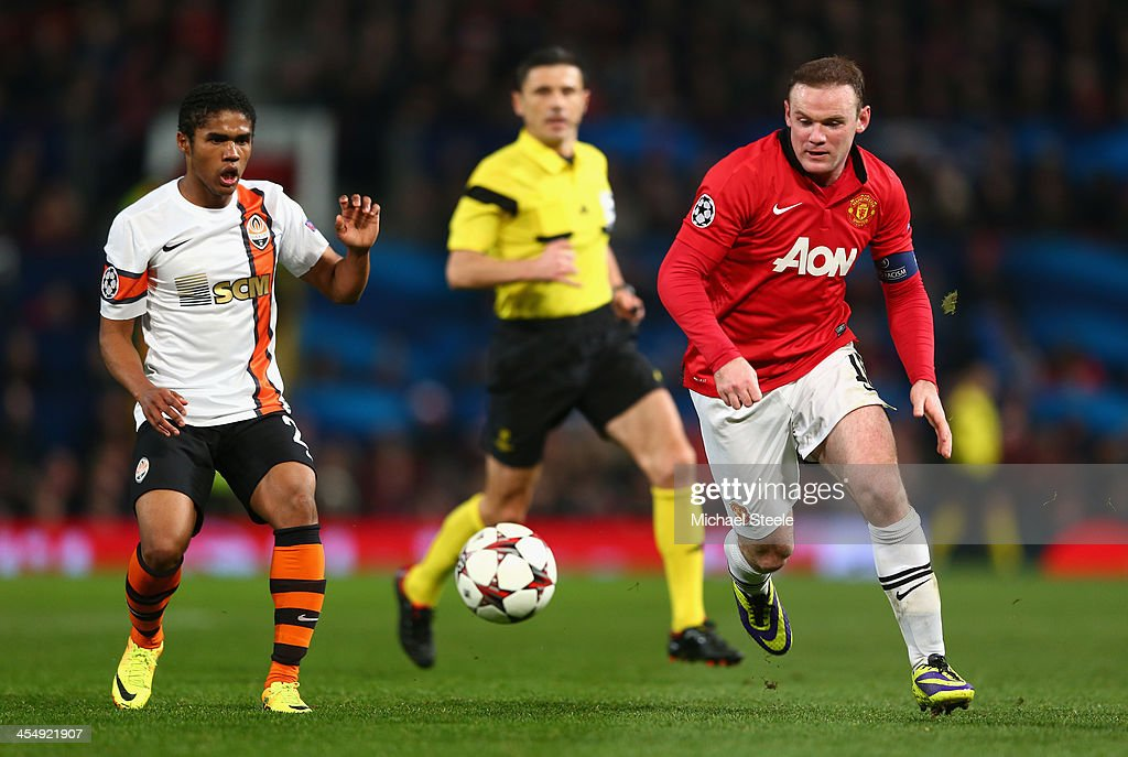 <a gi-track='captionPersonalityLinkClicked' href=/galleries/search?phrase=Wayne+Rooney&family=editorial&specificpeople=157598 ng-click='$event.stopPropagation()'>Wayne Rooney</a> of Manchester United competes with <a gi-track='captionPersonalityLinkClicked' href=/galleries/search?phrase=Douglas+Costa+-+Soccer+Forward+-+Born+1990&family=editorial&specificpeople=5672410 ng-click='$event.stopPropagation()'>Douglas Costa</a> of Shakhtar Donetsk during the UEFA Champions League Group A match between Manchester United and Shakhtar Donetsk at Old Trafford on December 10, 2013 in Manchester, England.