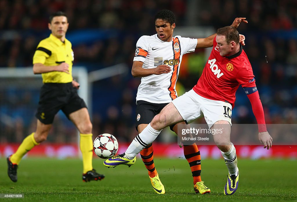 <a gi-track='captionPersonalityLinkClicked' href=/galleries/search?phrase=Wayne+Rooney&family=editorial&specificpeople=157598 ng-click='$event.stopPropagation()'>Wayne Rooney</a> of Manchester United competes with <a gi-track='captionPersonalityLinkClicked' href=/galleries/search?phrase=Douglas+Costa+-+Soccer+Forward+born+1990&family=editorial&specificpeople=5672410 ng-click='$event.stopPropagation()'>Douglas Costa</a> of Shakhtar Donetsk during the UEFA Champions League Group A match between Manchester United and Shakhtar Donetsk at Old Trafford on December 10, 2013 in Manchester, England.