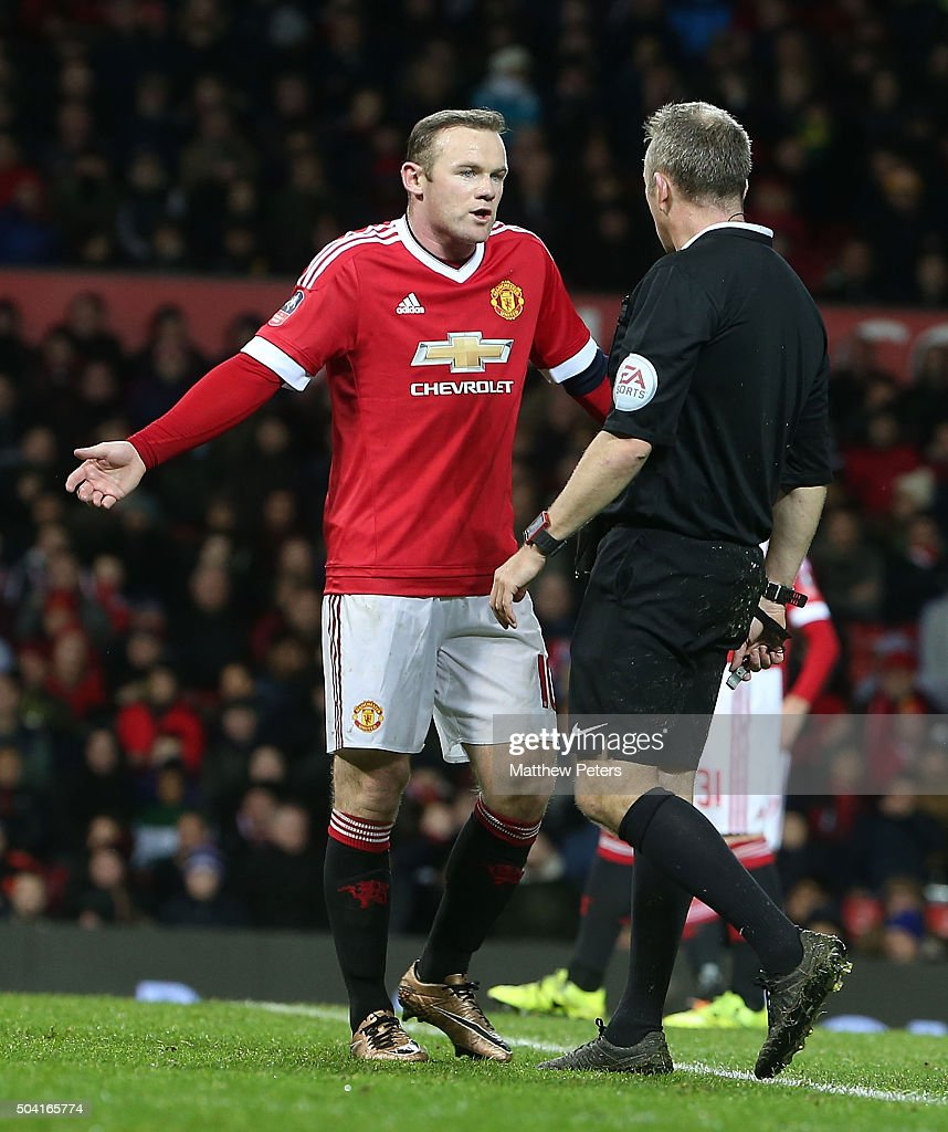 <a gi-track='captionPersonalityLinkClicked' href=/galleries/search?phrase=Wayne+Rooney&family=editorial&specificpeople=157598 ng-click='$event.stopPropagation()'>Wayne Rooney</a> of Manchester United complains to referee Jon Moss during the Emirates FA Cup Third round match between Manchester United and Sheffield United at Old Trafford on January 9, 2016 in Manchester, England.