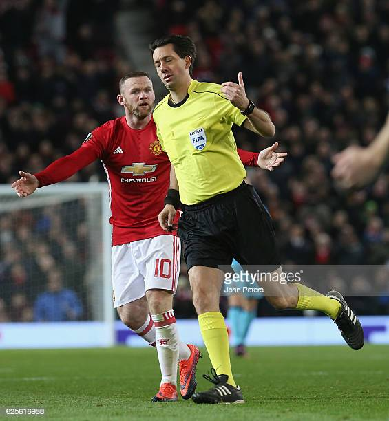 Wayne Rooney of Manchester United complains to referee Manuel Grafe during the UEFA Europa League match between Manchester United FC and Feyenoord at...