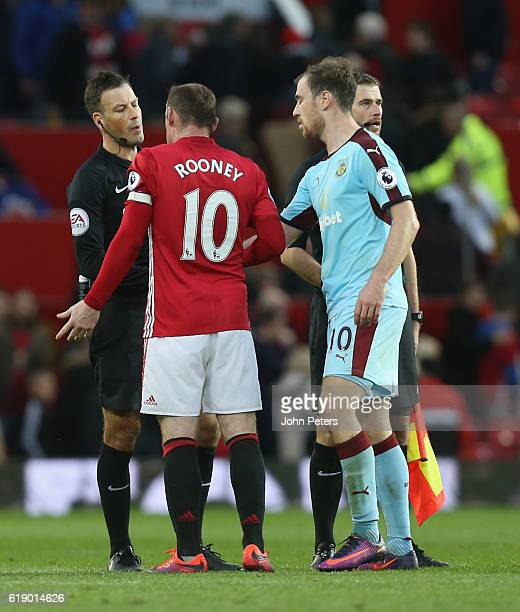 Wayne Rooney of Manchester United complains to referee Mark Clattenburg after the Premier League match between Manchester United and Burnley at Old...