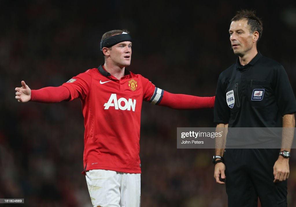 Wayne Rooney of Manchester United complains to referee Mark Clattenburg during the Capital Cup Third Round match between Manchester United and Liverpool at Old Trafford on September 25, 2013 in Manchester, England.