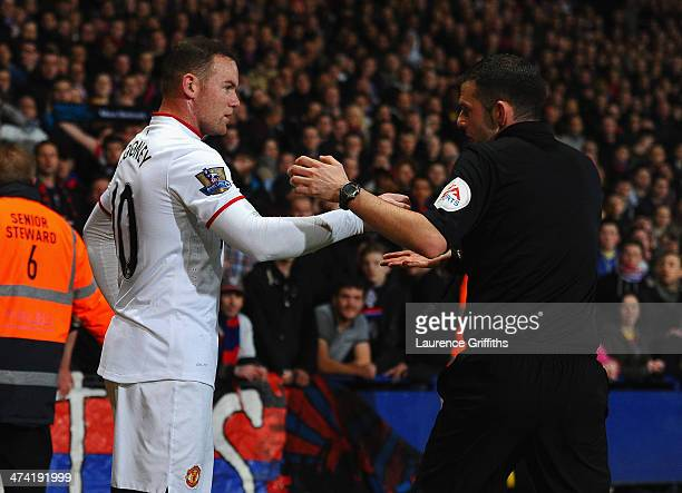 Wayne Rooney of Manchester United complains to Referee Mr M Oliver after having coins thrown at him by the fans during the Barclays Premier League...