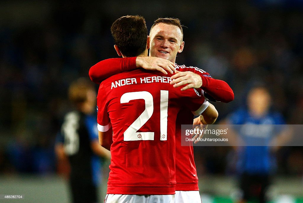 Wayne Rooney of Manchester United congratulates fellow goalscorer Ander Herrera of Manchester United during the UEFA Champions League qualifying round play off 2nd leg match between Club Brugge and Manchester United held at Jan Breydel Stadium on August 26, 2015 in Brugge, Belgium.