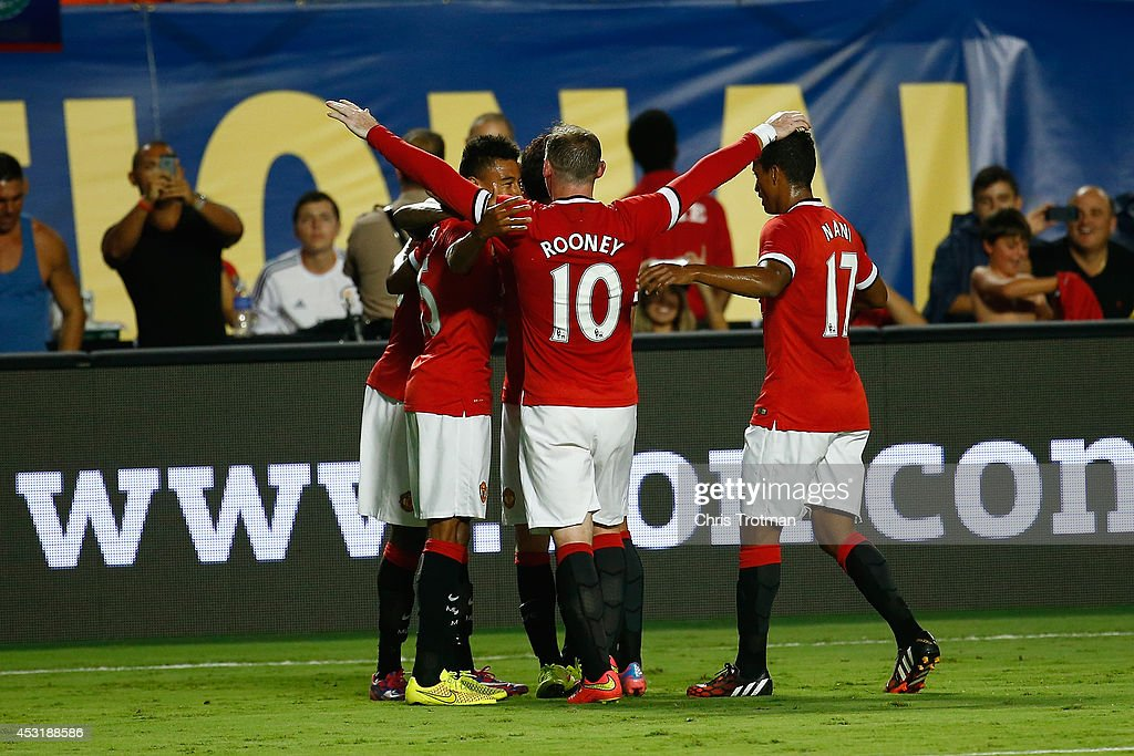 Wayne Rooney #10 of Manchester United congratulates his teammate Jesse Lingard #35 of Manchester United for his goal against Liverpool in the Guinness International Champions Cup 2014 Final at Sun Life Stadium on August 4, 2014 in Miami Gardens, Florida. United defeated Liverpool 3-1.