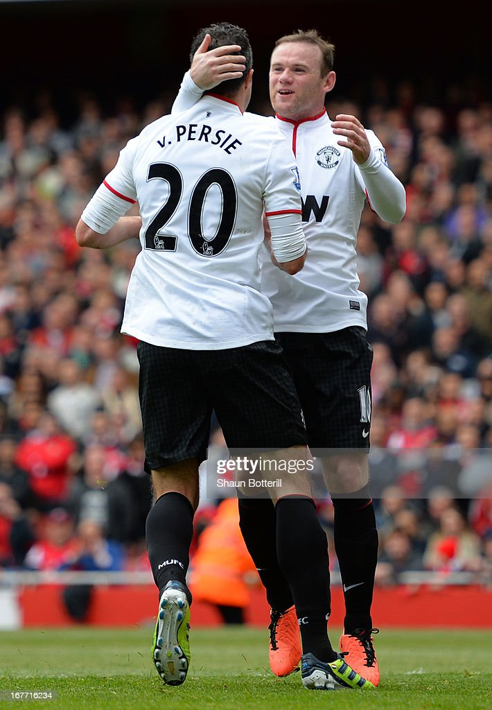 <a gi-track='captionPersonalityLinkClicked' href=/galleries/search?phrase=Wayne+Rooney&family=editorial&specificpeople=157598 ng-click='$event.stopPropagation()'>Wayne Rooney</a> of Manchester United congratulates Robin van Persie of Manchester United after he scored from the penalty spot to make it 1-1 during the Barclays Premier League match between Arsenal and Manchester United at Emirates Stadium on April 28, 2013 in London, England.