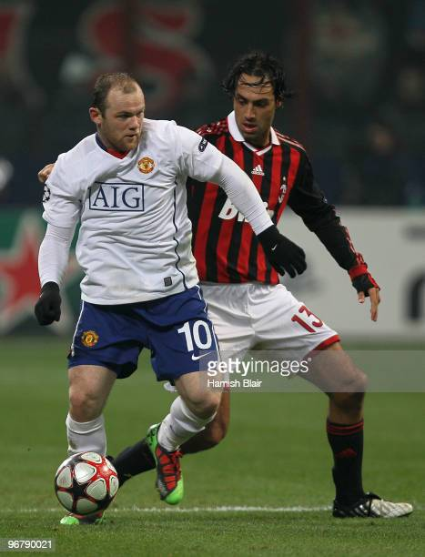 Wayne Rooney of Manchester United contests with Alessandro Nesta of AC Milan during the UEFA Champions League round of 16 first leg match between AC...
