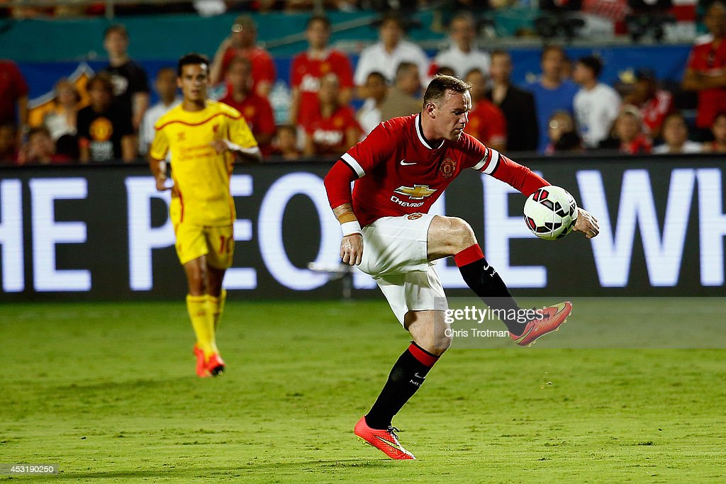 <a gi-track='captionPersonalityLinkClicked' href=/galleries/search?phrase=Wayne+Rooney&family=editorial&specificpeople=157598 ng-click='$event.stopPropagation()'>Wayne Rooney</a> #10 of Manchester United controls the ball against Liverpool in the Guinness International Champions Cup 2014 Final at Sun Life Stadium on August 4, 2014 in Miami Gardens, Florida.