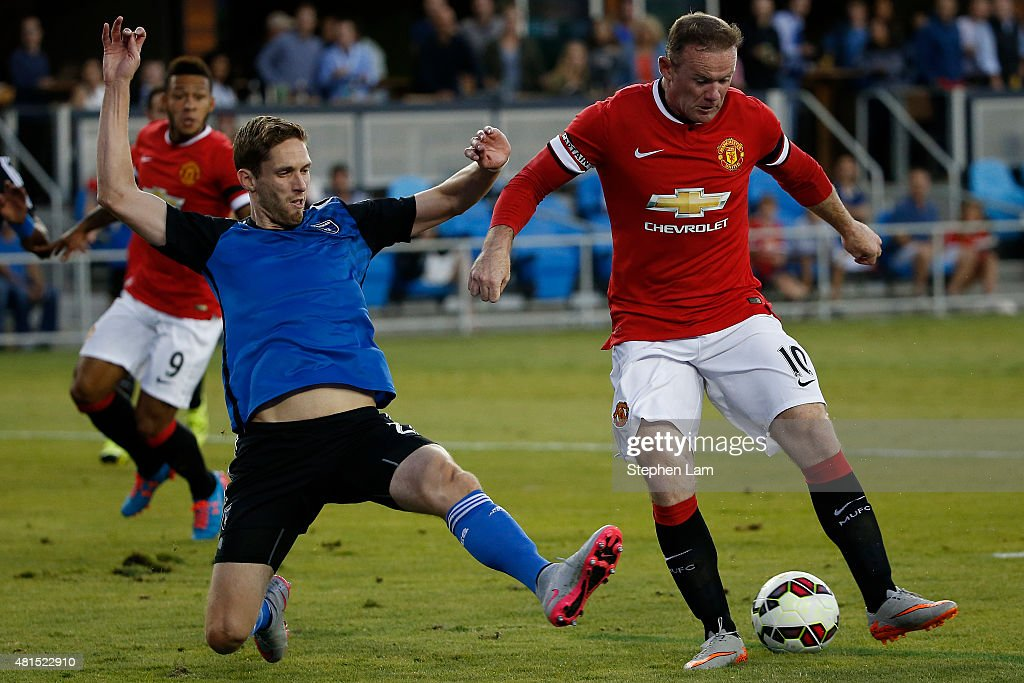 Wayne Rooney #10 of Manchester United drives the ball as Clarence Goodson #21 of San Jose Earthquakes defends during the first half of their International Champions Cup match on July 21, 2015 at Avaya Stadium in San Jose, California.