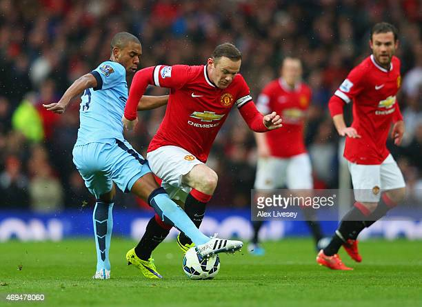 Wayne Rooney of Manchester United evades Fernandinho of Manchester City during the Barclays Premier League match between Manchester United and...