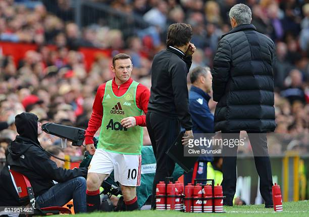 Wayne Rooney of Manchester United gets ready to come on during the Premier League match between Manchester United and Stoke City at Old Trafford on...