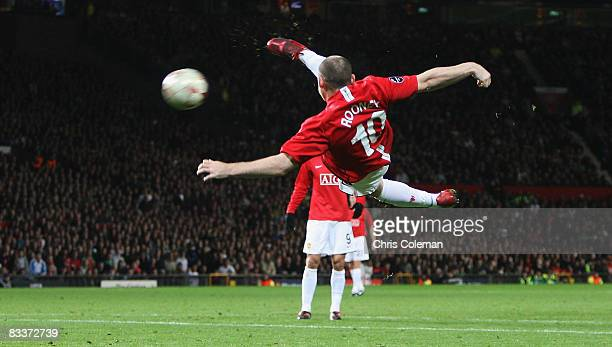 Wayne Rooney of Manchester United has a shot during the UEFA Champions League Group E match between Manchester United and Celtic at Old Trafford on...