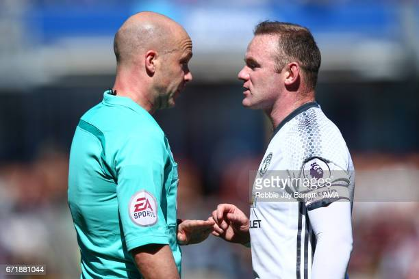Wayne Rooney of Manchester United has a word with Referee Andrew Taylor during the Premier League match between Burnley and Manchester United at Turf...