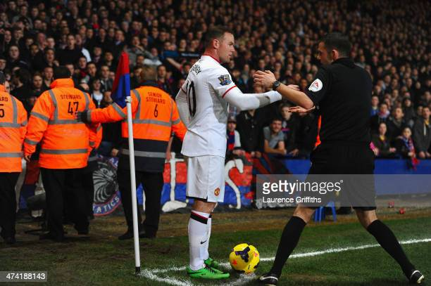 Wayne Rooney of Manchester United has coins thrown at him by the fans during the Barclays Premier League match between Crystal Palace and Manchester...