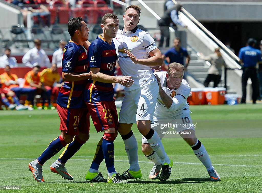<a gi-track='captionPersonalityLinkClicked' href=/galleries/search?phrase=Wayne+Rooney&family=editorial&specificpeople=157598 ng-click='$event.stopPropagation()'>Wayne Rooney</a> #10 of Manchester United hides behind teammate <a gi-track='captionPersonalityLinkClicked' href=/galleries/search?phrase=Phil+Jones+-+Soccer+Player&family=editorial&specificpeople=7841291 ng-click='$event.stopPropagation()'>Phil Jones</a> #4 while <a gi-track='captionPersonalityLinkClicked' href=/galleries/search?phrase=Adriano+-+Soccer+Defender+and+Midfielder+-+Born+1984&family=editorial&specificpeople=640788 ng-click='$event.stopPropagation()'>Adriano</a> #21and <a gi-track='captionPersonalityLinkClicked' href=/galleries/search?phrase=Thomas+Vermaelen&family=editorial&specificpeople=1360240 ng-click='$event.stopPropagation()'>Thomas Vermaelen</a> #23 of FC Barcelona defend a corner kick their friendly soccer match in the International Champions Cup at Levi's Stadium July 25, 2015 in Santa Clara, California.
