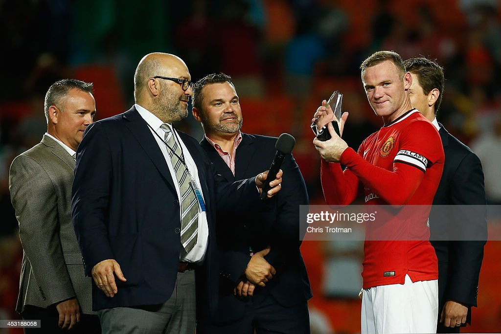 Wayne Rooney #10 of Manchester United holds the man of the match award following his team's victory over Liverpool in the Guinness International Champions Cup 2014 Final at Sun Life Stadium on August 4, 2014 in Miami Gardens, Florida. United defeated Liverpool 3-1.