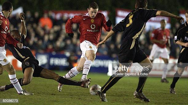 Wayne Rooney of Manchester United in action against Exeter City during the FA Cup Third Round replay between Exeter City and Manchester United at St...