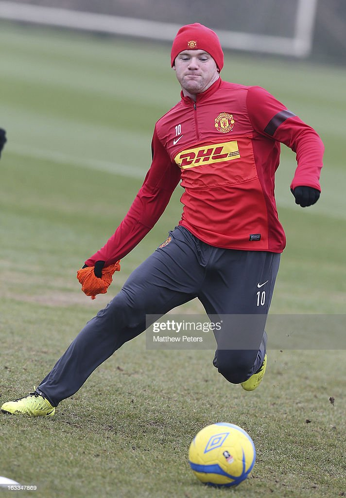 <a gi-track='captionPersonalityLinkClicked' href=/galleries/search?phrase=Wayne+Rooney&family=editorial&specificpeople=157598 ng-click='$event.stopPropagation()'>Wayne Rooney</a> of Manchester United in action during a first team training session at Carrington Training Ground on March 8, 2013 in Manchester, England.