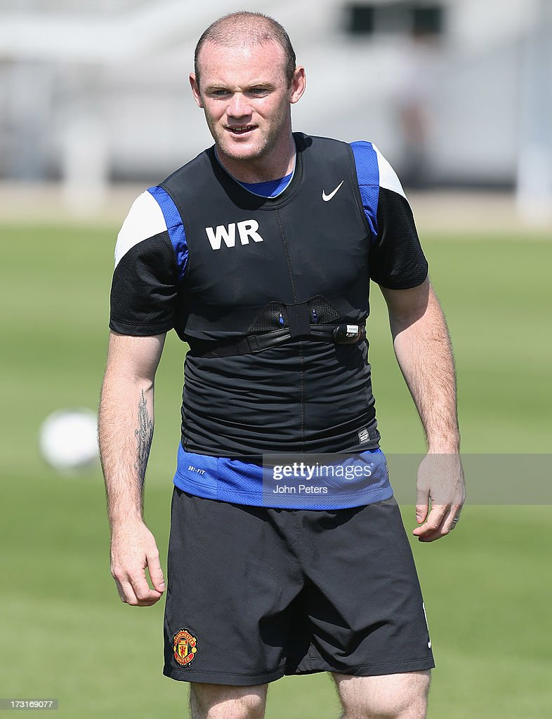 Wayne Rooney of Manchester United in action during a first team training session at the Aon Training Complex on July 9, 2013 in Manchester, England.