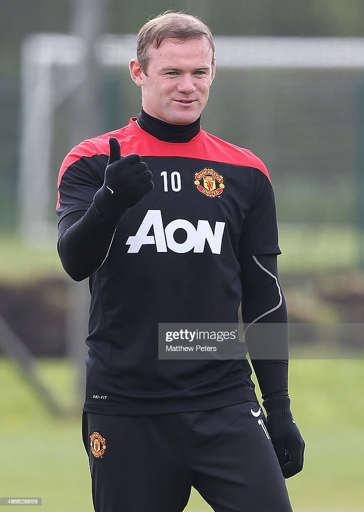 Wayne Rooney of Manchester United in action during a first team training session at Aon Training Complex on April 25, 2014 in Manchester, England.