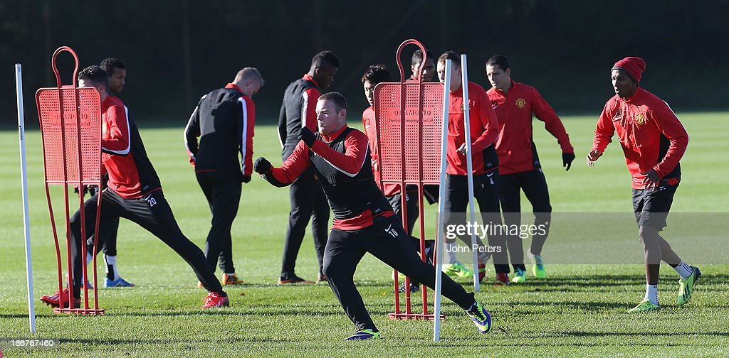 <a gi-track='captionPersonalityLinkClicked' href=/galleries/search?phrase=Wayne+Rooney&family=editorial&specificpeople=157598 ng-click='$event.stopPropagation()'>Wayne Rooney</a> of Manchester United in action during a first team training session, ahead of their UEFA Champions League Group A match against Real Sociedad, at the Aon Training Complex on November 4, 2013 in Manchester, England.