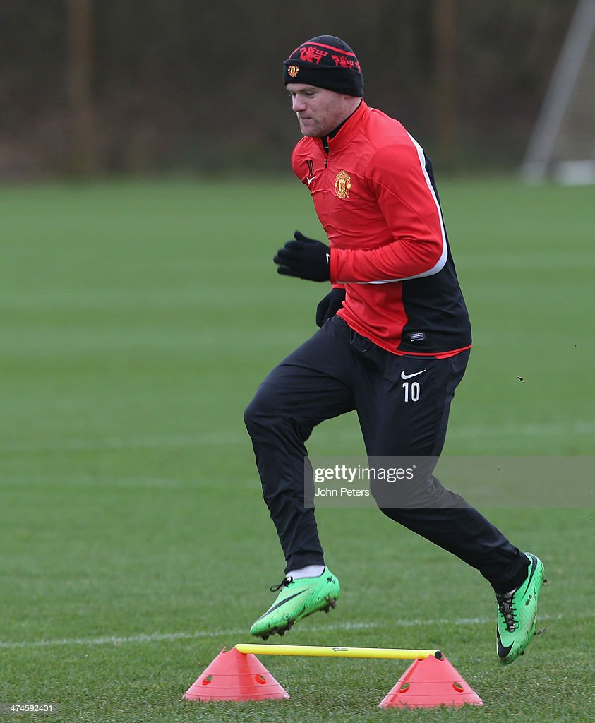 Wayne Rooney of Manchester United in action during a first team training session, ahead of their UEFA Champions League Round of 16 match against Olympiacos, at Aon Training Complex on February 24, 2014 in Manchester, England.