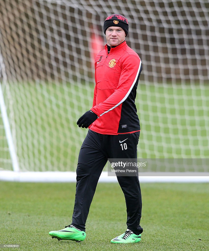 <a gi-track='captionPersonalityLinkClicked' href=/galleries/search?phrase=Wayne+Rooney&family=editorial&specificpeople=157598 ng-click='$event.stopPropagation()'>Wayne Rooney</a> of Manchester United in action during a first team training session, ahead of their UEFA Champions League Round of 16 match against Olympiacos, at Aon Training Complex on February 24, 2014 in Manchester, England.