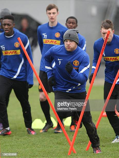 Wayne Rooney of Manchester United in action during a training session at Carrington Training Ground on December 30 2011 in Manchester England