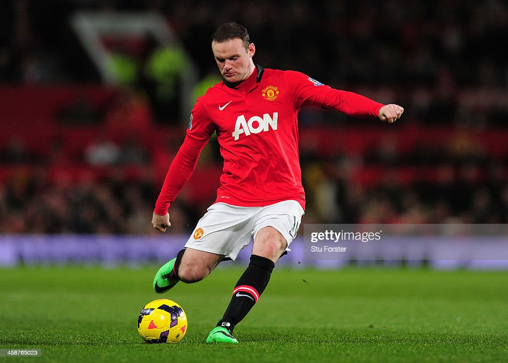 <a gi-track='captionPersonalityLinkClicked' href=/galleries/search?phrase=Wayne+Rooney&family=editorial&specificpeople=157598 ng-click='$event.stopPropagation()'>Wayne Rooney</a> of Manchester United in action during the Barclays Premier League match between Manchester United and West Ham United at Old Trafford on December 21, 2013 in Manchester, England.