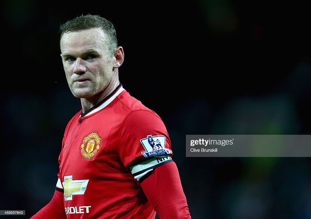 <a gi-track='captionPersonalityLinkClicked' href=/galleries/search?phrase=Wayne+Rooney&family=editorial&specificpeople=157598 ng-click='$event.stopPropagation()'>Wayne Rooney</a> of Manchester United in action during the Pre Season Friendly match between Manchester United and Valencia at Old Trafford on August 12, 2014 in Manchester, England.