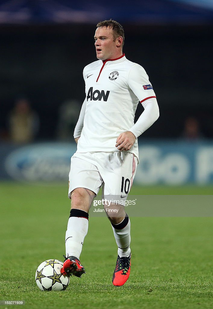 <a gi-track='captionPersonalityLinkClicked' href=/galleries/search?phrase=Wayne+Rooney&family=editorial&specificpeople=157598 ng-click='$event.stopPropagation()'>Wayne Rooney</a> of Manchester United in action during the UEFA Champions League Group H match between CFR 1907 Cluj and Manchester United at the Constantin Radulescu Stadium on October 2, 2012 in Cluj-Napoca, Romania.