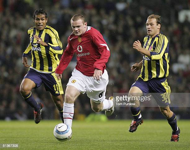 Wayne Rooney of Manchester United in action on the ball during the UEFA Champions League match between Manchester United and Fenerbahce at Old...