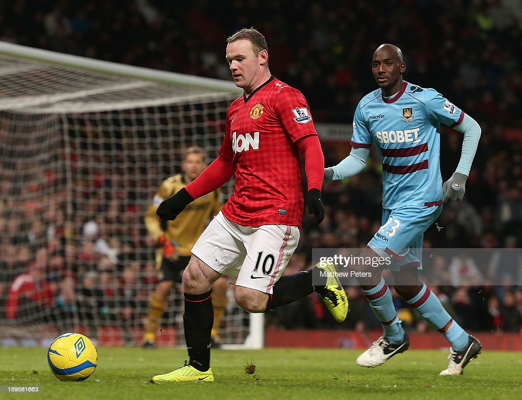 <a gi-track='captionPersonalityLinkClicked' href=/galleries/search?phrase=Wayne+Rooney&family=editorial&specificpeople=157598 ng-click='$event.stopPropagation()'>Wayne Rooney</a> of Manchester United in action with <a gi-track='captionPersonalityLinkClicked' href=/galleries/search?phrase=Alou+Diarra&family=editorial&specificpeople=465019 ng-click='$event.stopPropagation()'>Alou Diarra</a> of West Ham United during the FA Cup Third Round Replay between Manchester United and West Ham United at Old Trafford on January 16, 2013 in Manchester, England.