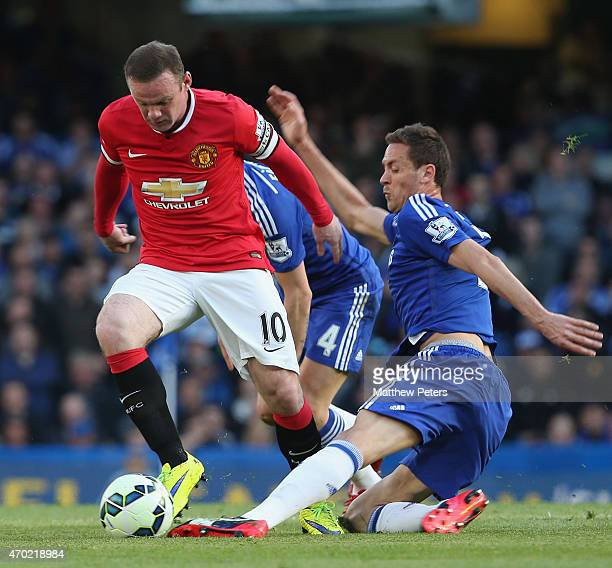 Wayne Rooney of Manchester United in action with Cesar Azpilicueta of Chelsea during the Barclays Premier League match between Chelsea and Manchester...