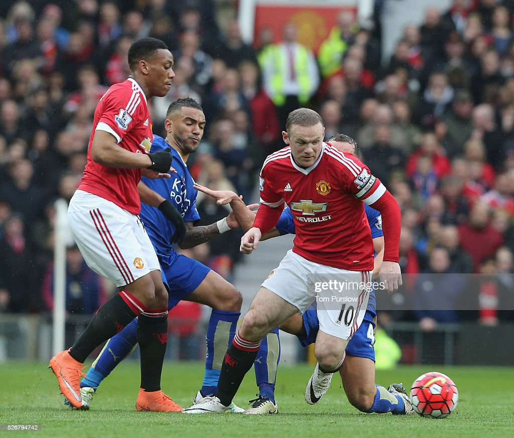 <a gi-track='captionPersonalityLinkClicked' href=/galleries/search?phrase=Wayne+Rooney&family=editorial&specificpeople=157598 ng-click='$event.stopPropagation()'>Wayne Rooney</a> of Manchester United in action with <a gi-track='captionPersonalityLinkClicked' href=/galleries/search?phrase=Danny+Simpson&family=editorial&specificpeople=803074 ng-click='$event.stopPropagation()'>Danny Simpson</a> and <a gi-track='captionPersonalityLinkClicked' href=/galleries/search?phrase=Danny+Drinkwater&family=editorial&specificpeople=4224396 ng-click='$event.stopPropagation()'>Danny Drinkwater</a> of Leicester City during the Barclays Premier League match between Manchester United and Leicester City at Old Trafford on May 1, 2016 in Manchester, England.