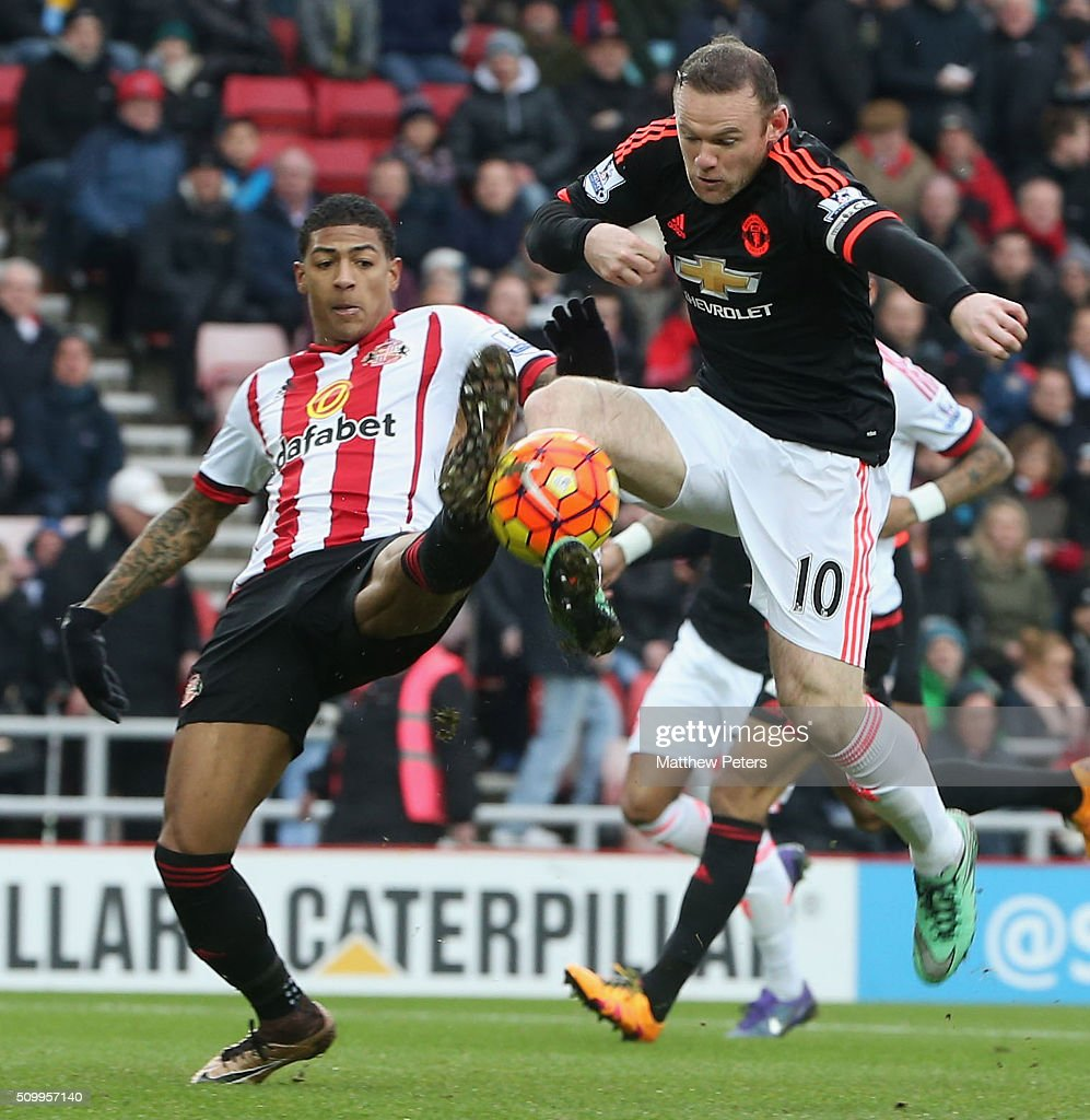 Wayne Rooney of Manchester United in action with DeAndre Yedlin of Sunderland during the Barclays Premier League match between Sunderland and Manchester United at Stadium of Light on February 13, 2016 in Sunderland, England.