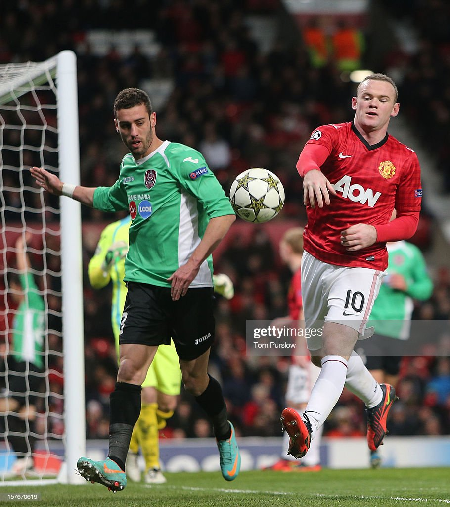 <a gi-track='captionPersonalityLinkClicked' href=/galleries/search?phrase=Wayne+Rooney&family=editorial&specificpeople=157598 ng-click='$event.stopPropagation()'>Wayne Rooney</a> of Manchester United in action with Ivo Pinto of CFR 1907 Cluj during the UEFA Champions League Group H match between Manchester United and CFR 1907 Cluj at Old Trafford on December 5, 2012 in Manchester, England.