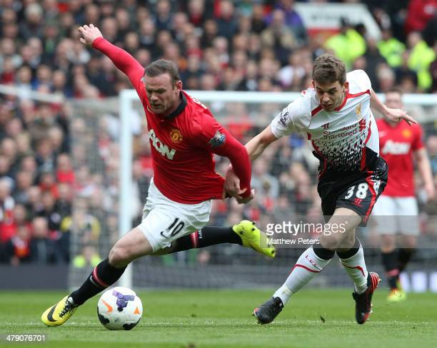Wayne Rooney of Manchester United in action with Jon Flanagan of Liverpool during the Barclays Premier League match between Manchester United and...