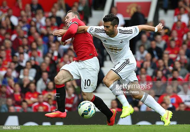 Wayne Rooney of Manchester United in action with Jordi Amat of Swansea City during the Barclays Premier League match between Manchester United and...