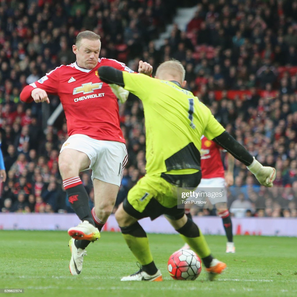 <a gi-track='captionPersonalityLinkClicked' href=/galleries/search?phrase=Wayne+Rooney&family=editorial&specificpeople=157598 ng-click='$event.stopPropagation()'>Wayne Rooney</a> of Manchester United in action with <a gi-track='captionPersonalityLinkClicked' href=/galleries/search?phrase=Kasper+Schmeichel&family=editorial&specificpeople=2309352 ng-click='$event.stopPropagation()'>Kasper Schmeichel</a> of Leicester City during the Barclays Premier League match between Manchester United and Leicester City at Old Trafford on May 1, 2016 in Manchester, England.