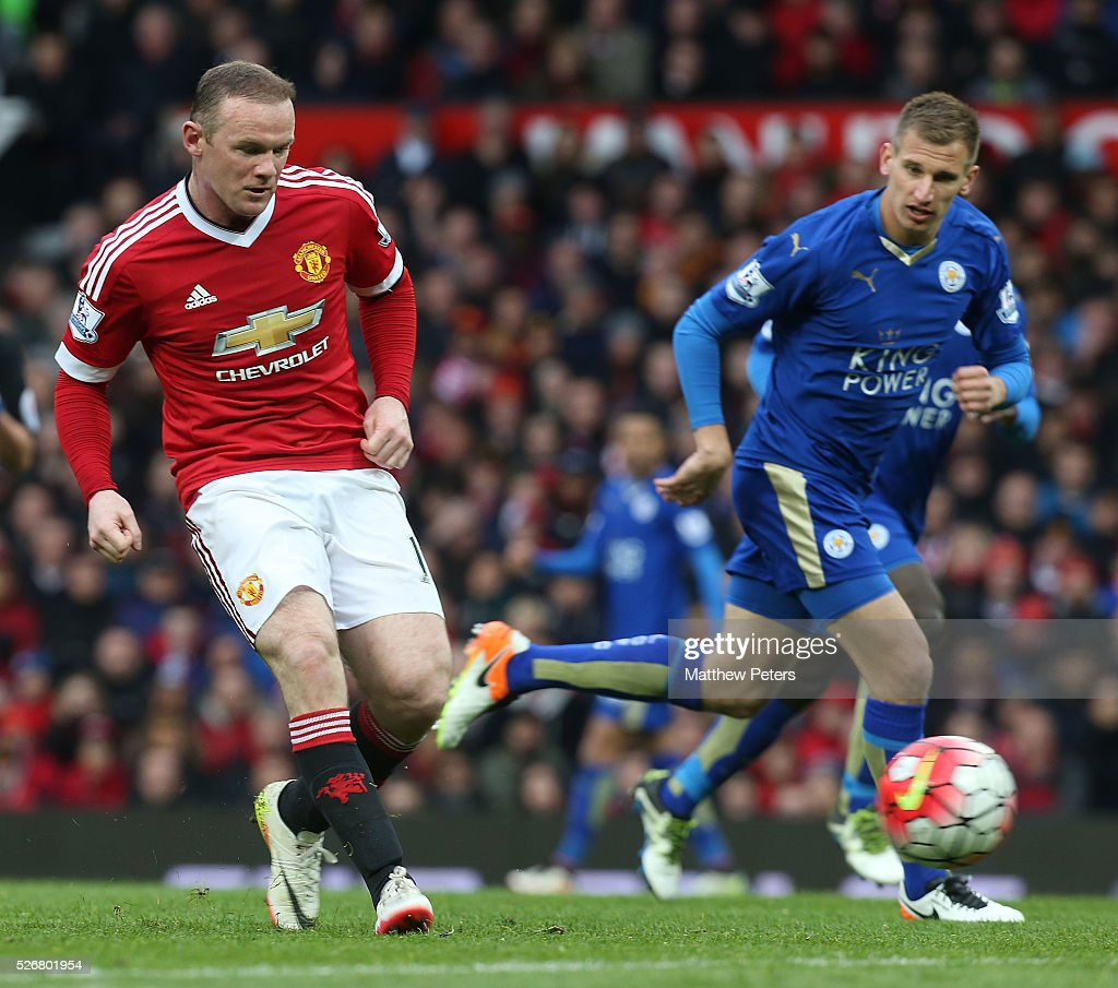 <a gi-track='captionPersonalityLinkClicked' href=/galleries/search?phrase=Wayne+Rooney&family=editorial&specificpeople=157598 ng-click='$event.stopPropagation()'>Wayne Rooney</a> of Manchester United in action with <a gi-track='captionPersonalityLinkClicked' href=/galleries/search?phrase=Marc+Albrighton+-+Ala&family=editorial&specificpeople=5734412 ng-click='$event.stopPropagation()'>Marc Albrighton</a> of Leicester City during the Barclays Premier League match between Manchester United and Leicester City at Old Trafford on May 1, 2016 in Manchester, England.