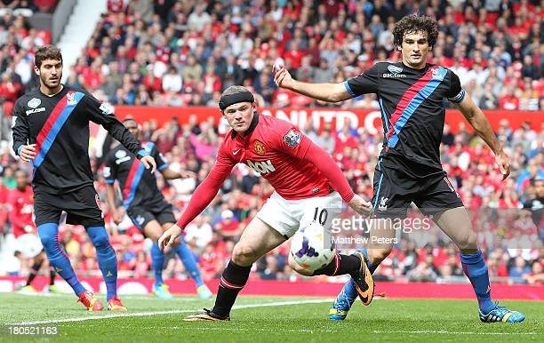 Wayne Rooney of Manchester United in action with Mile Jedinak of Crystal Palace during the Barclays Premier League match between Manchester United...
