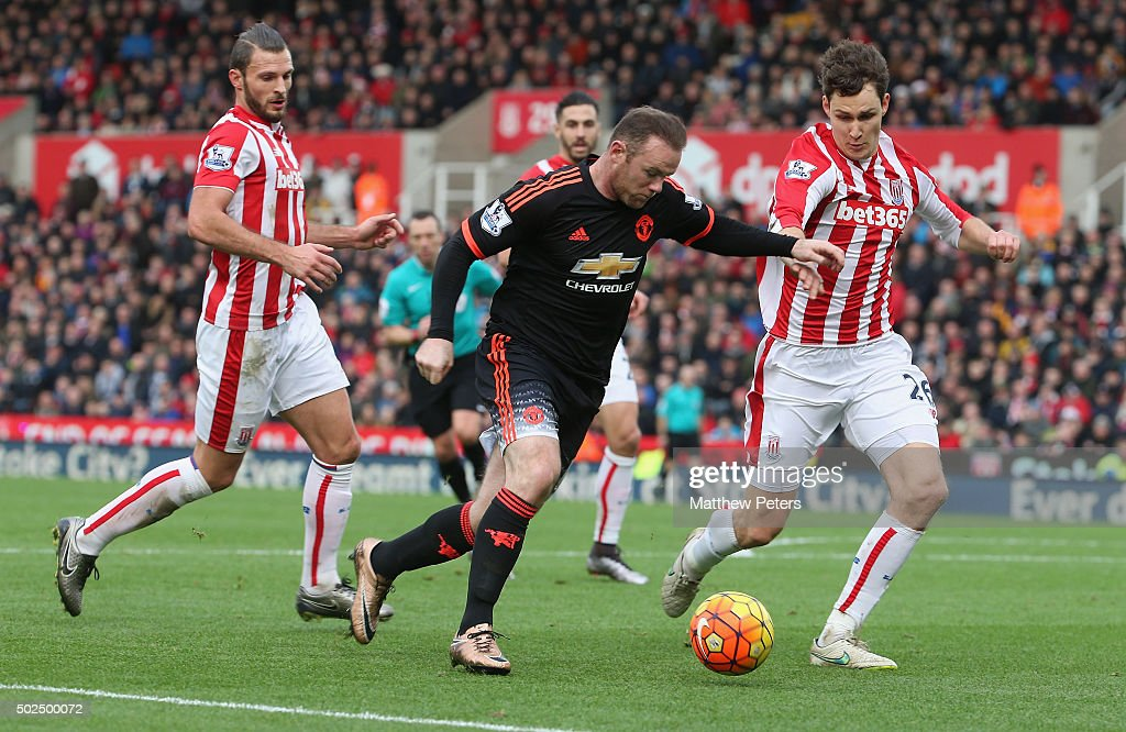 Wayne Rooney of Manchester United in action with Philipp Wollscheid of Stoke City during the Barclays Premier League match between Stoke City and Manchester United at Britannia Stadium on December 26, 2015 in Stoke on Trent, England.