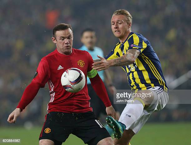 Wayne Rooney of Manchester United in action with Simon Kjaer of Fenerbahce during the UEFA Europa League match between Manchester United and...