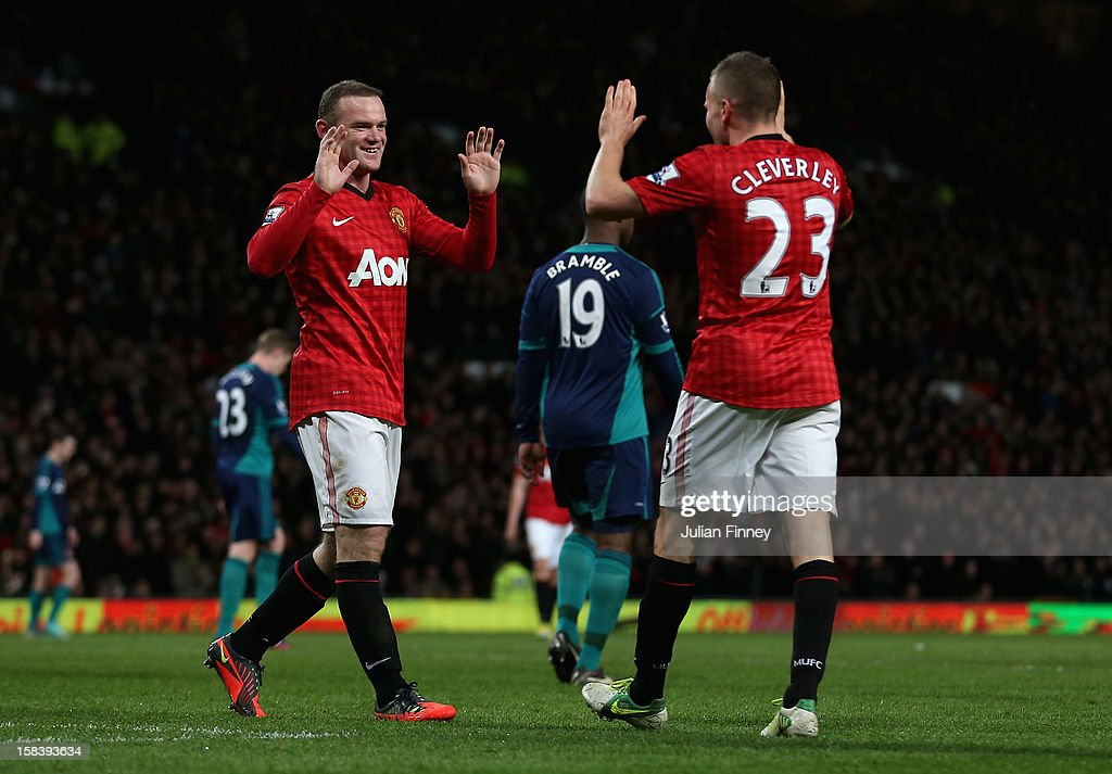 Wayne Rooney of Manchester United is congratulated by Tom Cleverley of Manchester United after he scored the third goal during the Barclays Premier League match between Manchester United and Sunderland at Old Trafford on December 15, 2012 in Manchester, England.