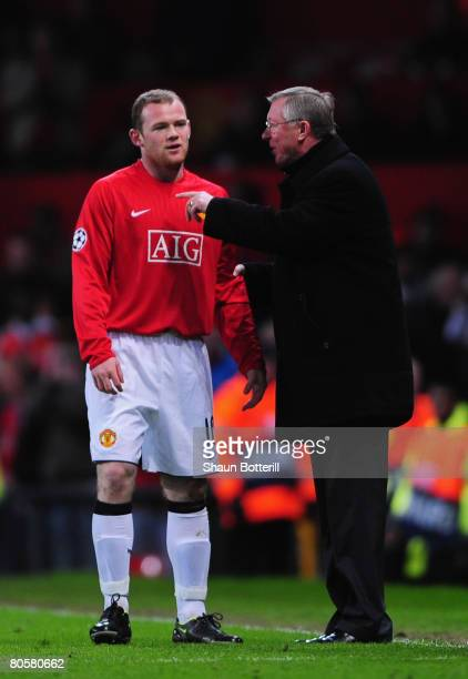 Wayne Rooney of Manchester United is given instructions by manager Sir Alex Ferguson as he comes on as a substitute during the UEFA Champions League...