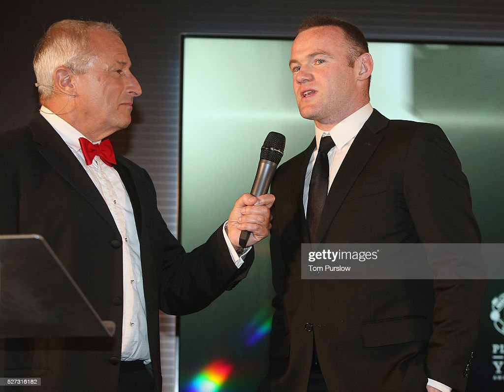 <a gi-track='captionPersonalityLinkClicked' href=/galleries/search?phrase=Wayne+Rooney&family=editorial&specificpeople=157598 ng-click='$event.stopPropagation()'>Wayne Rooney</a> of Manchester United is interviewed by host <a gi-track='captionPersonalityLinkClicked' href=/galleries/search?phrase=Jim+Rosenthal&family=editorial&specificpeople=1707616 ng-click='$event.stopPropagation()'>Jim Rosenthal</a> at the club's annual Player of the Year awards at Old Trafford on May 2, 2016 in Manchester, England.